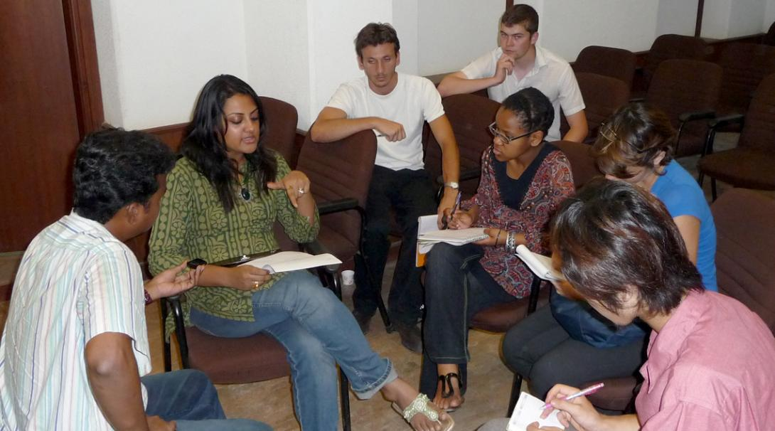 Nursing interns take notes during a medical lecture in India.